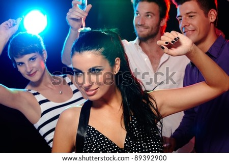 Young people having fun in discotheque, nightclub, dancing, drinking.?