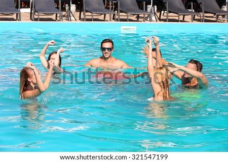 Young people having fun in the swimming pool