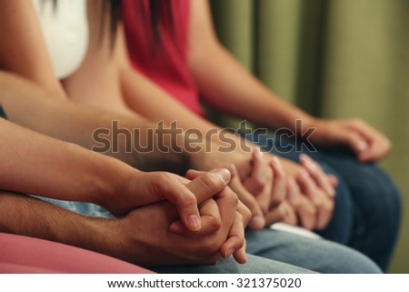 Young people holding hands close up