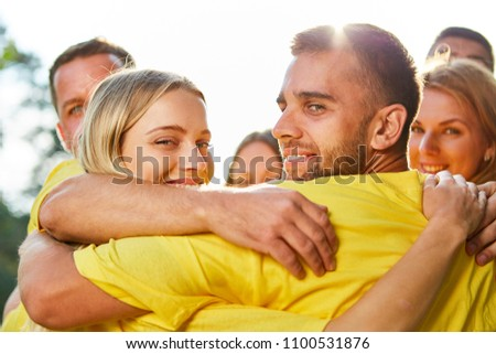 Young people hug happily at the teambuilding workshop in nature #1100531876