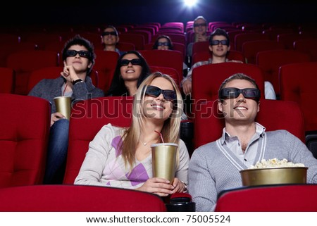 Young people in 3D glasses in cinema