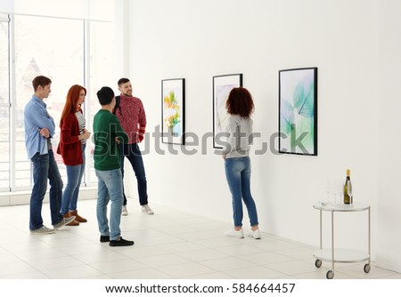 Young people in modern art gallery hall Сток-фото ©