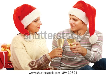 Young people in santa hat drinking champagne isolated on white background