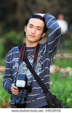 Young people in Taiwan with a camera in the park