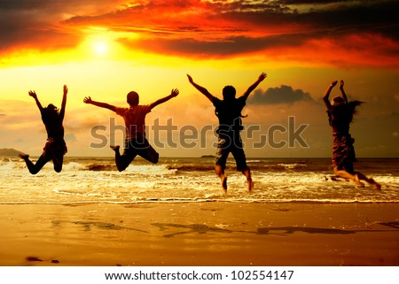 Young people in the beach silhouette