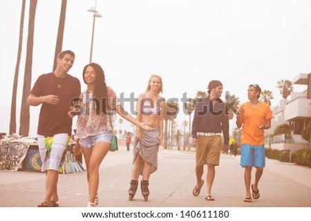 Young People in their twenties on the Venice Beach boaardwalk in California
