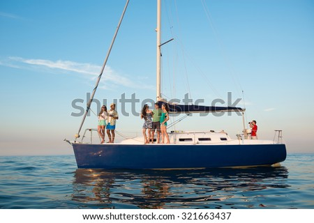 Young people is resting on a sailing yacht at sea. Weekend on a yacht. Yachting. Cruise on a yacht on the ocean. Guys and girls are traveling on a yacht. Youth party on a yacht.