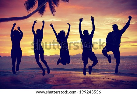 Young People Jumping with Excitement on the Beach #199243556