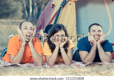 Young People Laying on the Ground on Camping