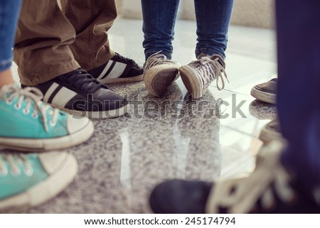 Young people legs standing in circle