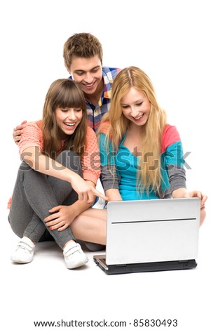 Young people looking at laptop