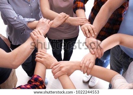 Young people making circle with their hands as symbol of unity #1022244553