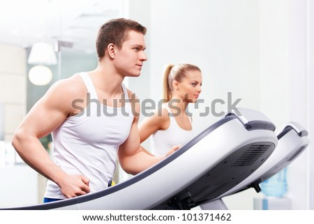 Young people on treadmills - stock photo