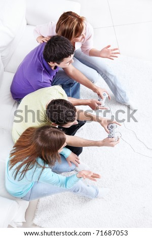 Young people playing video games