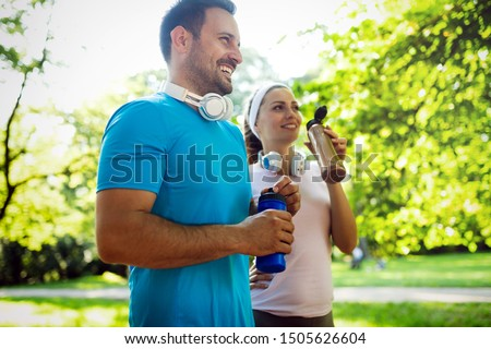 Young people running outdoors. Couple or friends of runners exercising in park #1505626604