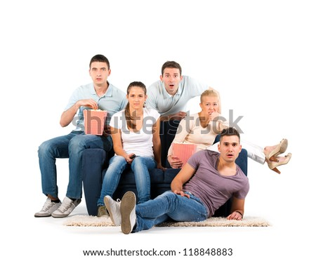 Young people sitting on a sofa. Anticipation. On white background