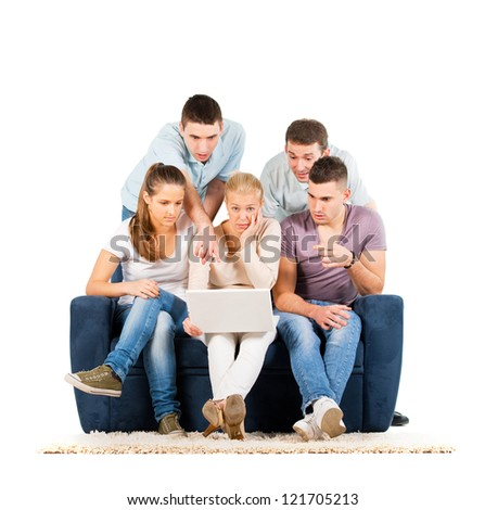 Young people sitting on a sofa, looking at a laptop, on white background