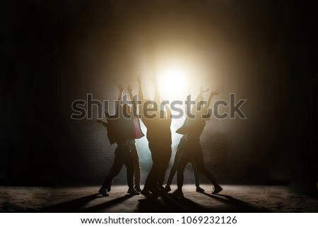 young people standing around with raised hands. praying together to the sun.influence of sect. worship light. worship the Sun. Sun cult. dancing movies