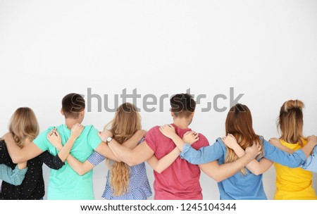 Young people together on light background. Unity concept #1245104344