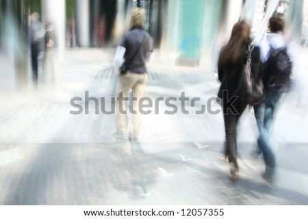 young people walking in the modern downtown