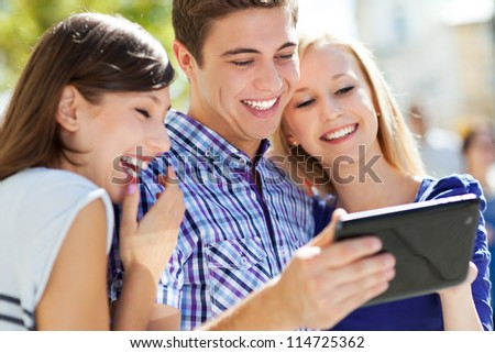 Young people with digital tablet
