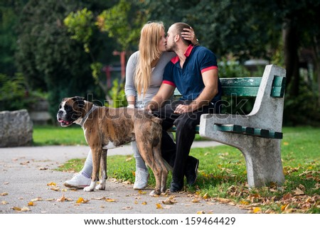 Young People With Their Dog In The Park
