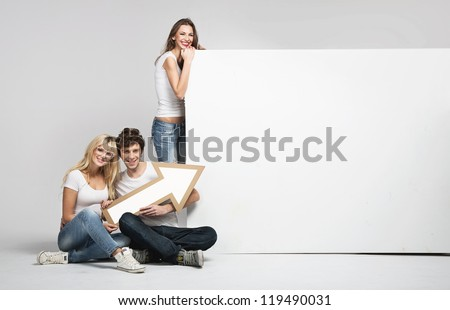 Young people with white advert