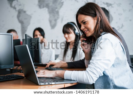 Young people working in the call center. New deals is coming. #1406191178