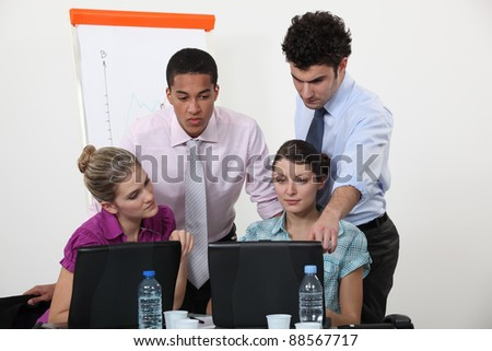 Young people working on a business presentation - stock photo