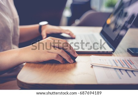 Young people working with modern laptop in workplace,cafe.business activity concepts #687694189