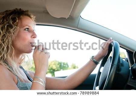 Young person eating sweets while driving car