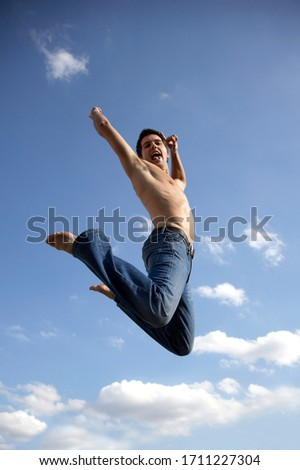 Young person jumping into the air with excitement