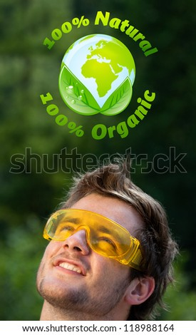 Young persons head looking at green eco sign