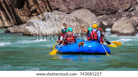young persons rafting on the...