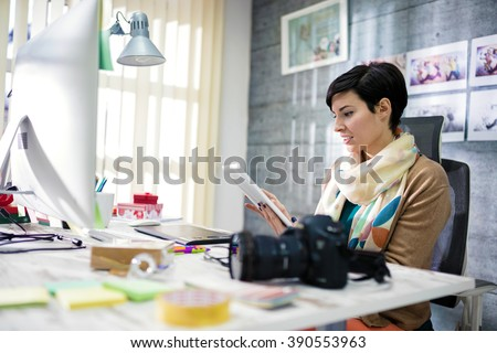 Young photographer and graphic designer at work in office #390553963