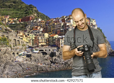 young photographer look the camera, cinque terre background