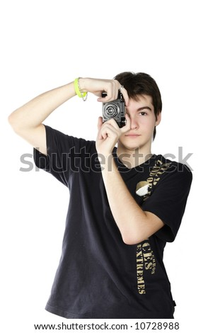 Young photographer taking a photo with retro slr camera - stock photo