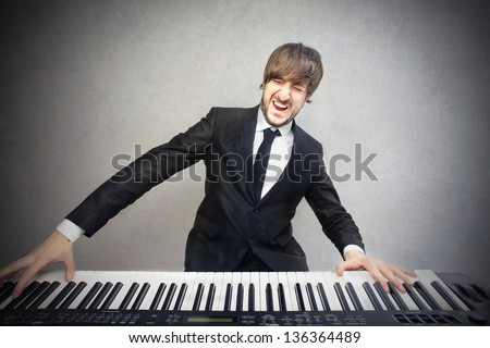 young pianist playing piano