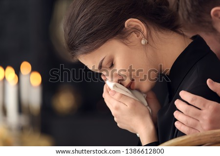Young pining woman at funeral