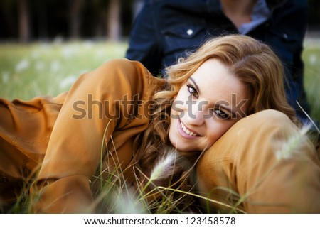 Young playful couple in the park