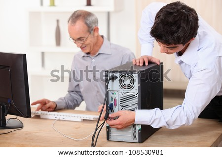 Young plugging computer Stock photo ©