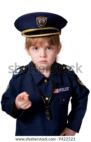 Young police girl sternly pointing at you.  Isolated on white.