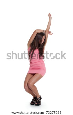 Young positive woman dancing in pink dress. Isolated over white background
