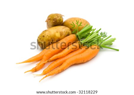 young potatoes and carrots on white background