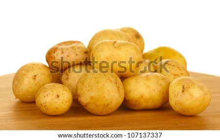 young potatoes on a cutting board on white background close-up