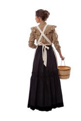 Young prairie woman in apron facing away looking left and holding a basket isolated on white