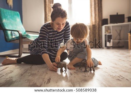 young pregnant mother with dreadlocks, and her son play and reading a book on sofa, lifestyle, real interior toning #508589038