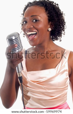young, pretty african-american woman with microphone performing a song