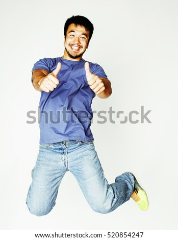 young pretty asian man jumping cheerful against white background, lifestyle people concept #520854247