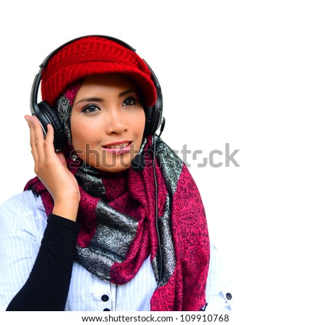 young pretty Asian muslim business woman in head scarf young pretty Asian muslim college girl with listen to music against white background